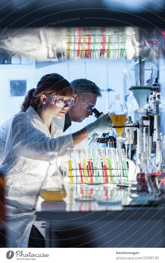 Health care researchers working in scientific laboratory. Medication Science & Research Professor Laboratory Examinations and Tests Work and employment Doctor