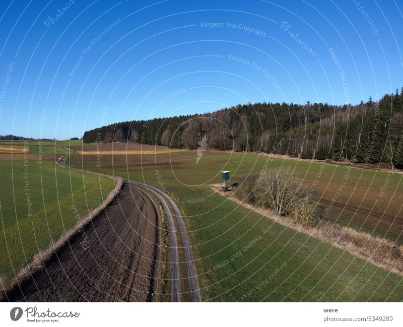 Aerial view of a dirt road between fields Environment Nature Field Large Infinity Town area flight bird's eye view copter country countryside drone flight