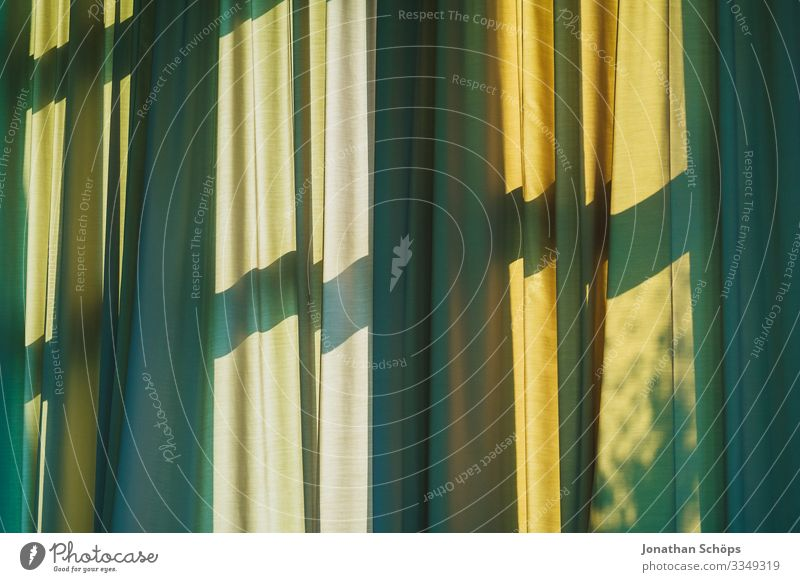 Curtain with shadow from window Drape Window Shadow Green Yellow Window transom and mullion Shadow play Pattern background crease Sunlight sun protection warm