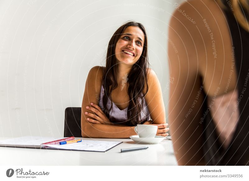 Coffee Break at Work Desk Happy Table Work and employment Profession Workplace Office To talk Young woman Youth (Young adults) Woman Adults Smiling Sit