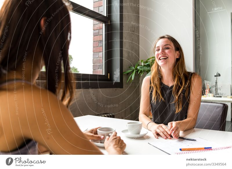 Coffee Discussion Over Work Desk Happy Table Work and employment Profession Workplace Office To talk Woman Adults Youth (Young adults) Smiling Laughter Sit