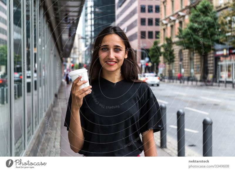 Young woman standing on sidewalk holding paper coffee cup Coffee Lifestyle Beautiful Woman Adults Youth (Young adults) Street Happiness Emotions
