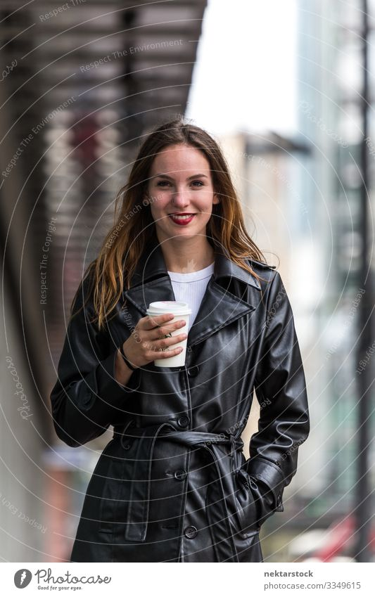 Portrait of Young Woman Holding Paper Coffee Cup Outdoors Lifestyle Beautiful Adults Youth (Young adults) Street Coat Leather Happiness Emotions