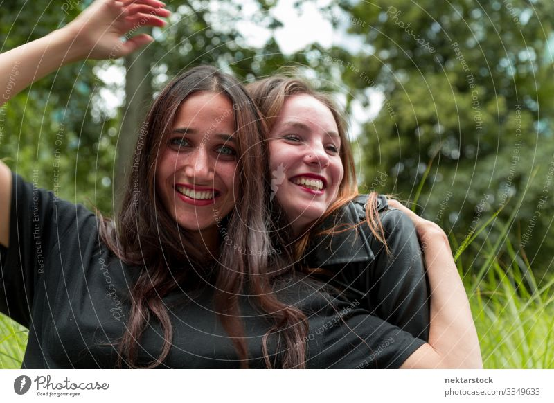 Middle Eastern and Caucasian Girls Hugging and Smiling Joy Beautiful Woman Adults Friendship Youth (Young adults) Nature Grass Embrace Happiness Together Cute