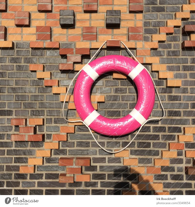 colourful lifebelt in the port of Hamburg Trip Port City Deserted Manmade structures Wall (barrier) Wall (building) Sign Life belt Hang Maritime Pink Trust
