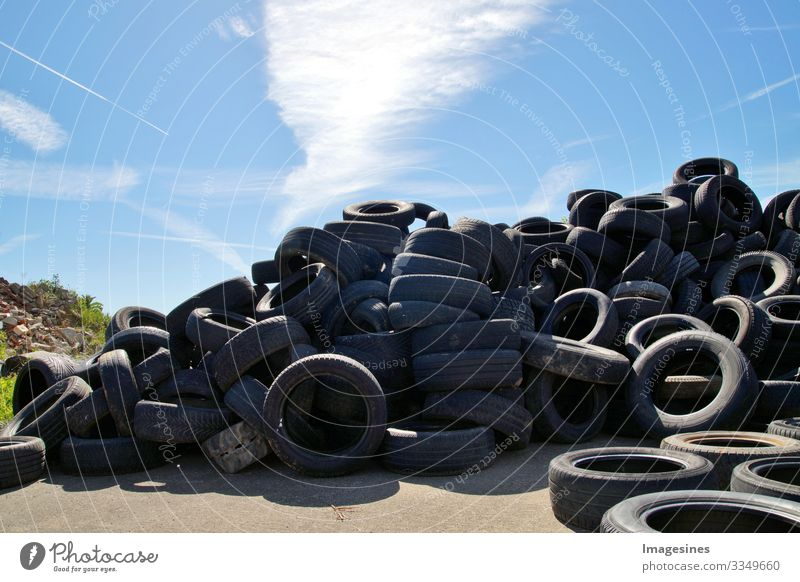 Garbage dump a bunch of tires, used old tires, a lot of car and truck tires at a garbage dump. Ecological background. Scrap yard Landfill Background Dispose of