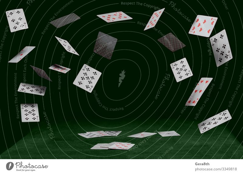 playing cards fall on a green table Playing Game of chance Table Animal Suit Pet Cat Heart Flying Dark Green Red Black Clubs Merchant Diamonds Spade Trumps Ace