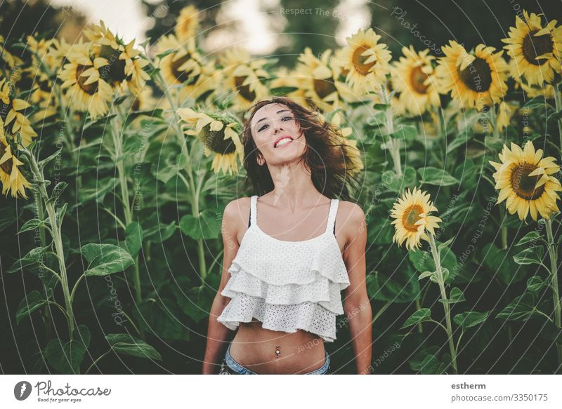 Young Woman in Sunflower Field Lifestyle Joy Beautiful Wellness Vacation & Travel Freedom Summer Summer vacation Human being Feminine Young woman