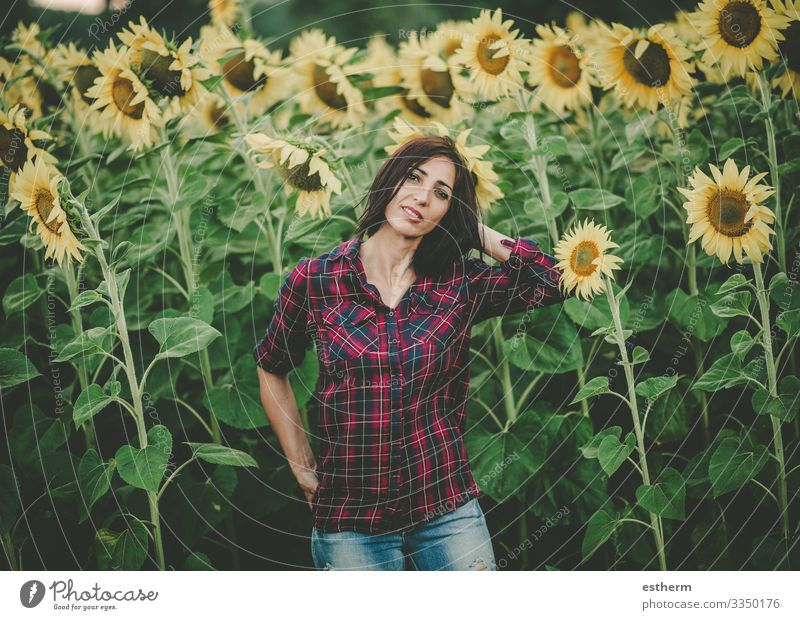 Young Woman in Sunflower Field Lifestyle Beautiful Wellness Vacation & Travel Freedom Summer Human being Feminine Young woman Youth (Young adults) Adults 1
