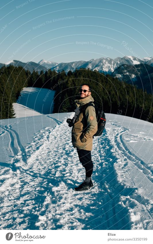 A man in the snow on a mountain on a sunny day with a view of the Alps. Hiking in winter. Human being winter hike Masculine Snow Young man Youth (Young adults)