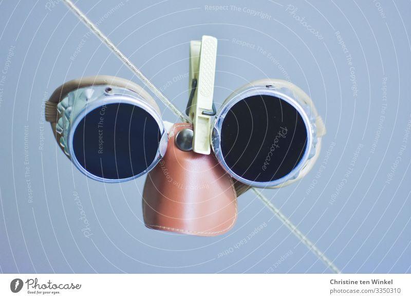 old glacier glasses hanging on a clothesline Glacier goggles Eyeglasses Saftey goggles Sunglasses Clothes peg Clothesline Hang Looking Authentic Happiness