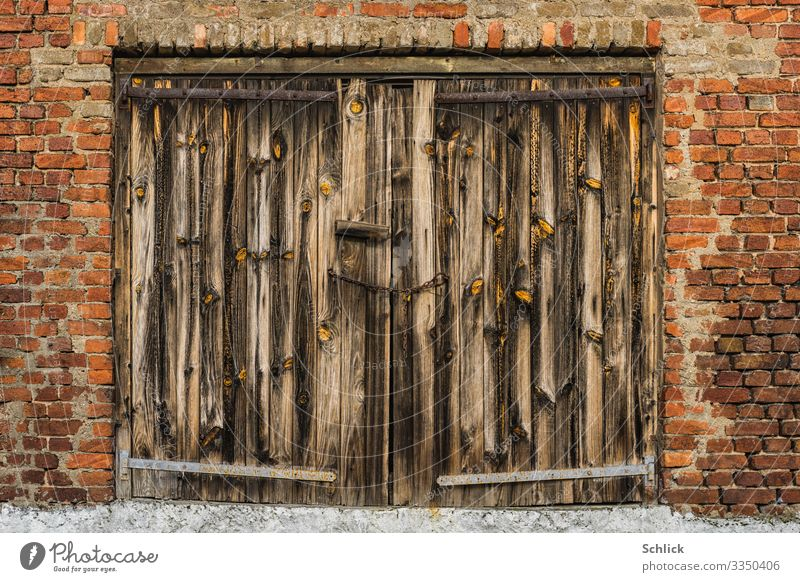 Old weathered wooden gate in brick wall Architecture Gate Wooden gate Wall (building) Transience Derelict Weathered Raw Wood grain Wood texture