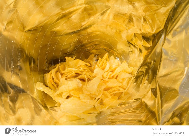 junk food Crisps Fat Nutrition Fast food Packaging Paper bag Healthy Metal Plastic Yellow Silver Insight Reflection Cooking oil Sunflower oil Metal foil