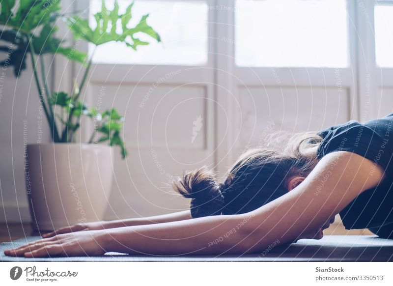 Woman doing yoga in the morning at her home. Pot Lifestyle Happy Beautiful Wellness Relaxation Meditation Sports Yoga Child Adults Plant Leaf Fitness Modern