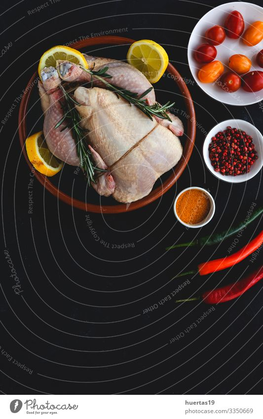 Whole uncooked chicken with herbs and spices Food Meat Vegetable Herbs and spices Nutrition Lunch Dinner Diet Bird Fresh Above Black Chicken Raw cooking