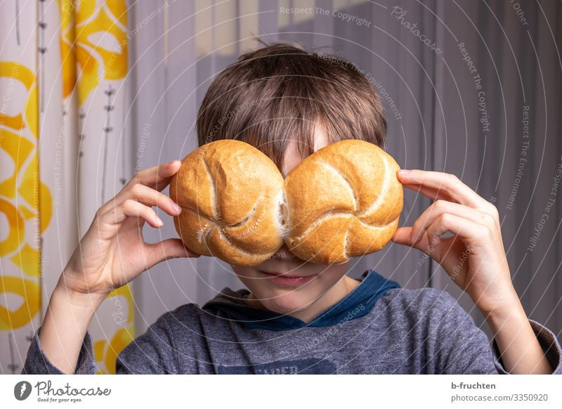 Child with twin buns Food Bread Roll Nutrition Eating Healthy Eating Playing Face Hand 1 Human being Eyeglasses Select To hold on Fragrance Happiness Fresh