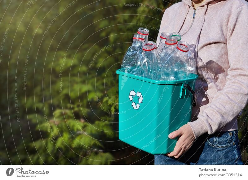 hands carry a box of plastic for recycling. Bottle Save Face Work and employment Craft (trade) Human being Environment Container Paper Plastic Smiling Carrying