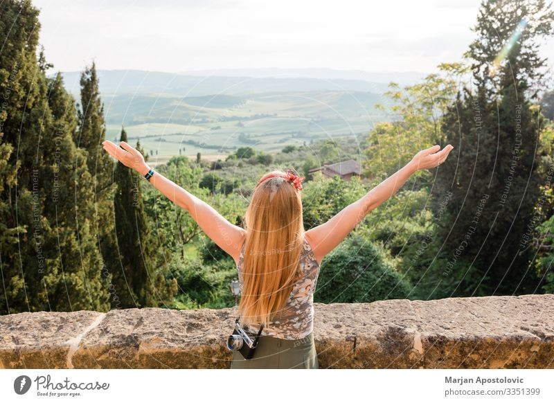 Young woman enjoying the view of the Tuscany landscape Lifestyle Vacation & Travel Tourism Trip Adventure Freedom Sightseeing Human being Feminine
