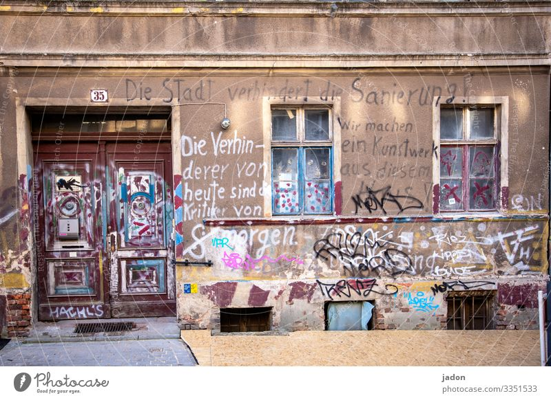 old house with interesting graffiti. House (Residential Structure) Facade Window Architecture Deserted Building Exterior shot Wall (building) Town Graffiti