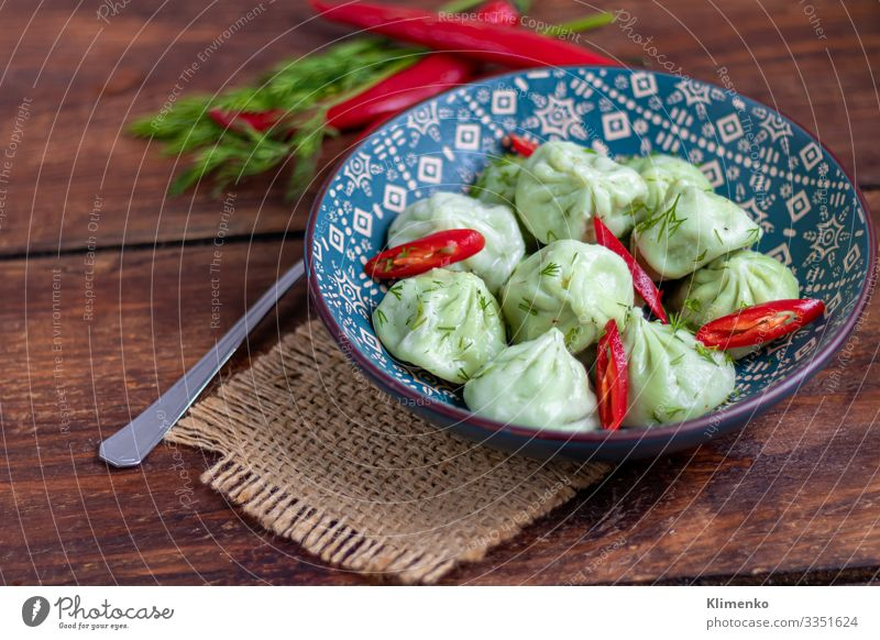 Boiled khinkali made of dough with spinach. Vegetable Fruit Nutrition Vegetarian diet Lemonade Juice Pan Summer Winter Tree Leaf Fresh Blue Green White Dumpling