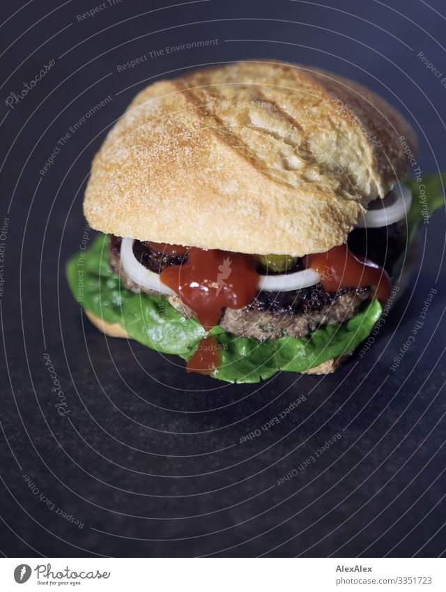 Hamburger sandwich with bread roll Food Meat Lettuce Salad Roll Ketchup Onion Fast food Delicious Finger food American Cuisine Eating Fragrance Esthetic
