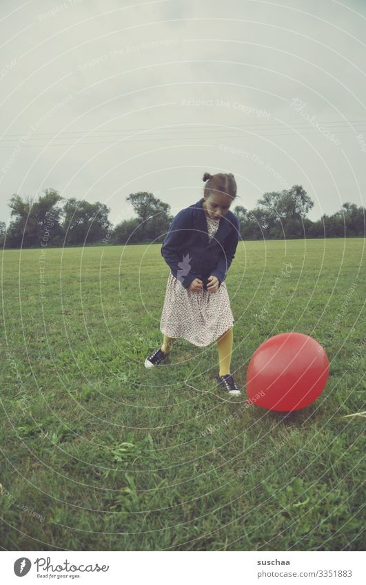 girl with a red balloon in a meadow Child Infancy Meadow Balloon Playing Old fashioned Retro Exterior shot Grass Environment Field Joy Landscape Dress