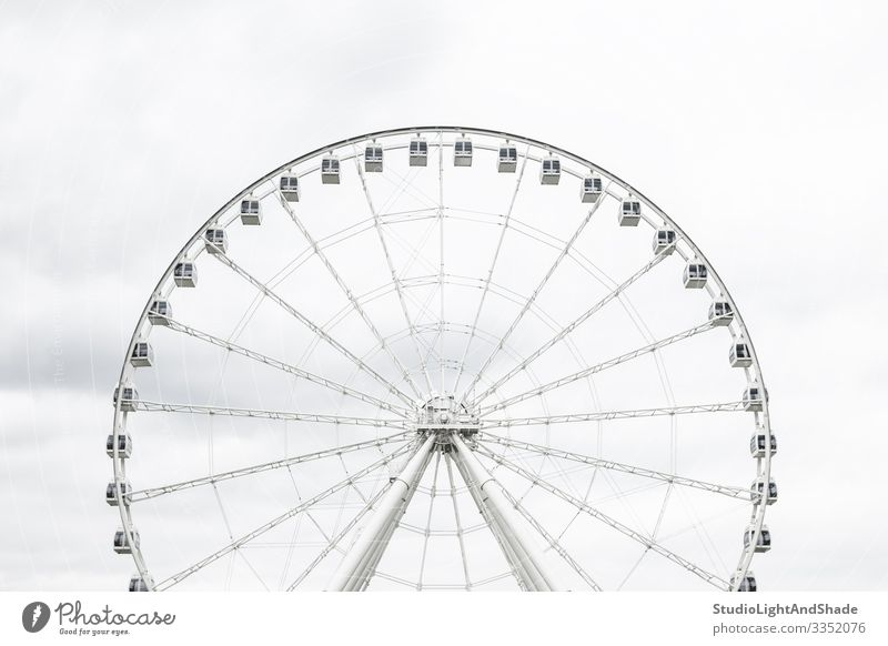 White observation wheel Elegant Tourism Sightseeing Entertainment Sky Clouds Architecture New Gray Great wheel Grande Roue Montreal Quebec Canada vieux Montreal