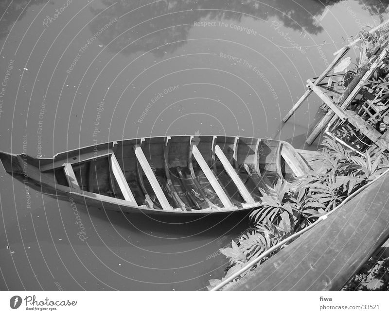 Boat at the shore Watercraft Wood Calm River Coast Black & white photo