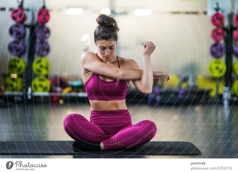 Young woman Doing Stretching Exercises on a yoga mat at the Gym Lifestyle Personal hygiene Body Wellness Club Disco Sports Yoga Human being Feminine Woman