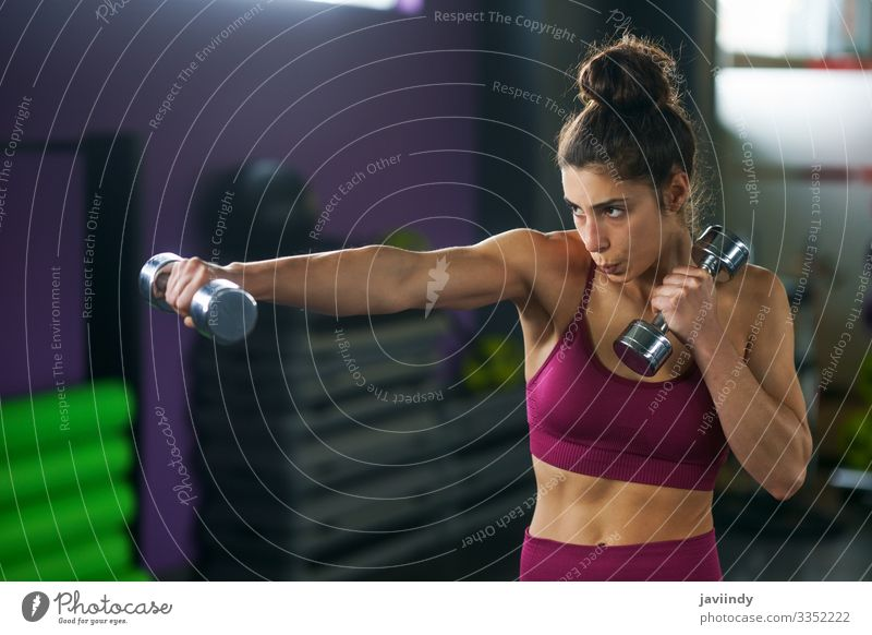Sporty woman punching and boxing with dumbbells. Lifestyle Beautiful Personal hygiene Wellness Sports Human being Feminine Young woman Youth (Young adults)