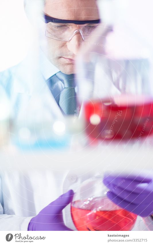 Chemist searching for the right solution. Bottle Medication Science & Research Laboratory Examinations and Tests Work and employment Doctor Hospital Technology