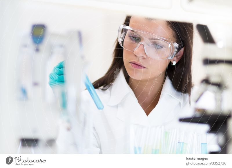 Female chemist working in scientific laboratory. Woman Human being Blue White Adults Health care Work and employment Technology Discover Medication