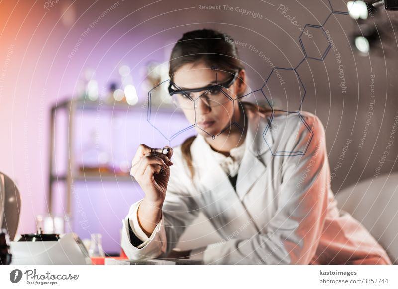 Female researcher in life science laboratory. Woman Blue White Adults Health care Work and employment Technology Academic studies Industry Write Profession
