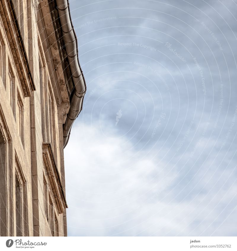 corner of a house against a cloudy sky. Facade Sky Architecture Window House (Residential Structure) Deserted Exterior shot Wall (barrier) Wall (building)