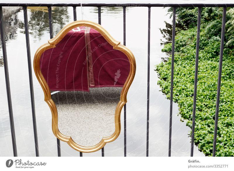 Mirror on bridge railing Mirror image reflection pile-lander Exterior shot River River bank Illusion daylight Ornament contrast Flea market Flea market stall
