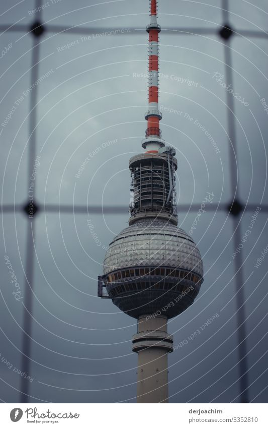 Berlin television tower behind bars. Close-up Tower Architecture Berlin TV Tower Landmark Sky Capital city Tourist Attraction Colour photo Germany