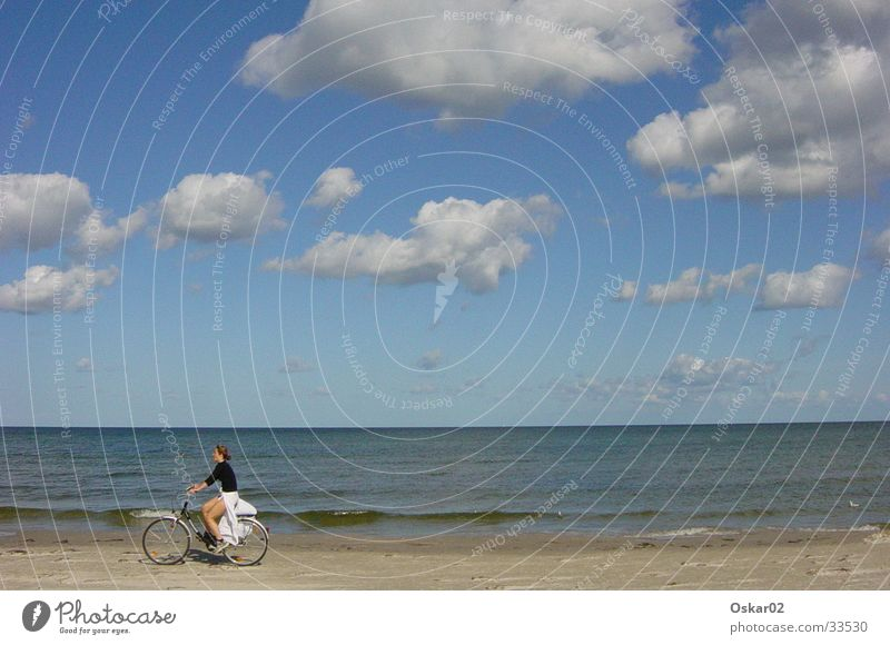 Bicycle on the beach Woman Beach Ocean Clouds