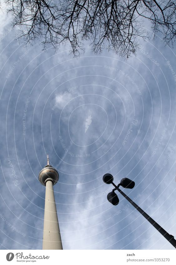 Berlin triad Sky Clouds Beautiful weather Town Capital city Downtown Tower Tourist Attraction Landmark Berlin TV Tower Television tower Large Tall Blue Gray