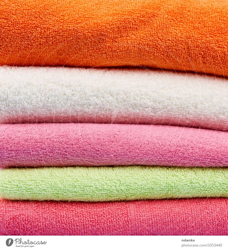 colored cotton terry folded towels Lifestyle Design Body Relaxation Spa Massage Fresh Modern New Clean Soft Green Pink Red White Colour textile Consistency