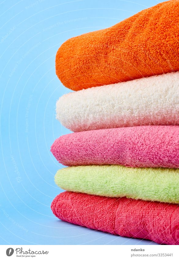 stack of colored cotton terry folded towels Lifestyle Design Body Relaxation Spa Massage Cloth Fresh Modern New Clean Soft Blue Green Pink Red White Colour