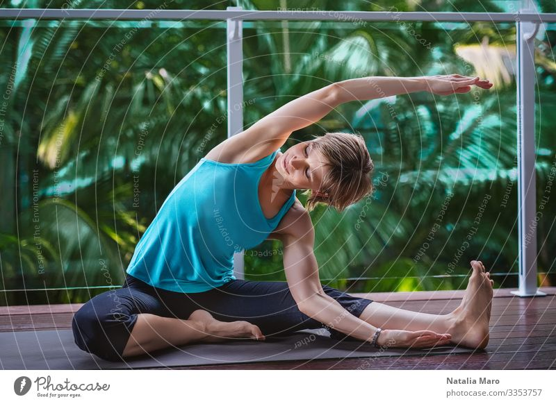 Woman doing yoga on the terrace in a tropical garden Beautiful Body Wellness Relaxation Meditation Summer House (Residential Structure) Garden Sports Yoga
