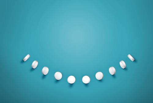line of pills making a white smile on teal background Nutrition Diet Elegant Style Joy Happy Face Healthy Health care Medical treatment Healthy Eating