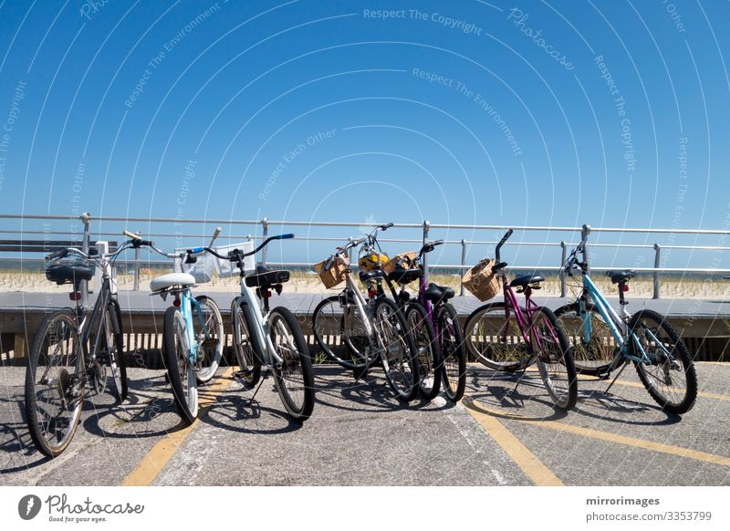 row or parked bikes at a beach boardwalk sea shoreline Beautiful Leisure and hobbies Vacation & Travel Tourism Summer Beach Ocean Fitness Sports Training