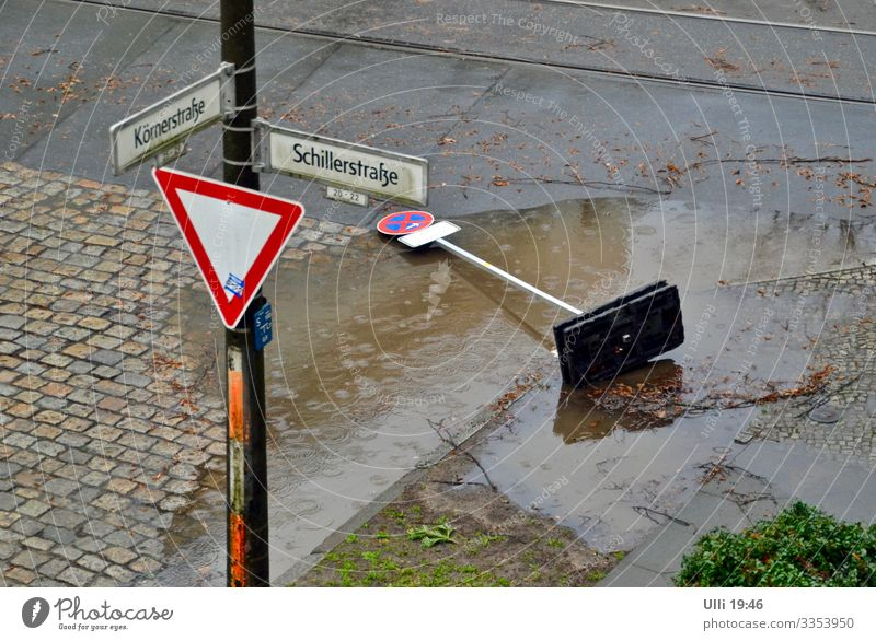 I didn't do it! It was Sabine! Earth Water Bad weather Storm Gale Rain Street Downtown Capital city Outskirts Deserted Crossroads Road sign Deluge Stone Sign