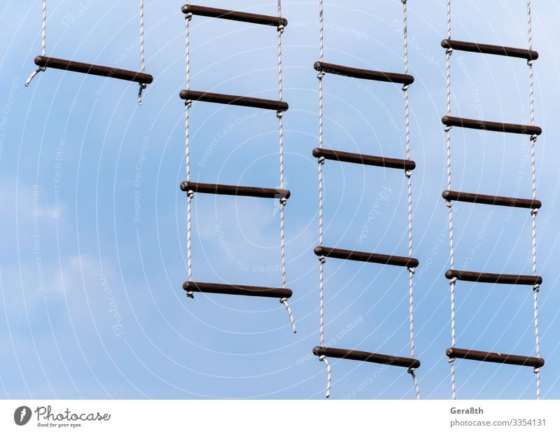 rope ladder against a blue sky and clouds Climbing Mountaineering Rope Sky Clouds Sphere Blue Colour abstract background crossbar empyrean ether footway get up