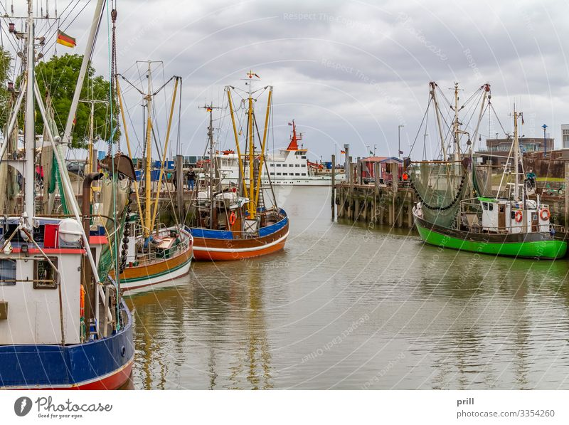Neuharlingersiel in East Frisia Relaxation Vacation & Travel Ocean Culture Water Fishing village Harbour Ferry Fishing boat Watercraft Tradition Drop anchor