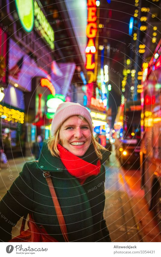 Vacation & Travel Young woman Winter Travel photography Cold Laughter Trip Signs and labeling Happiness USA Illuminate City trip Americas Sightseeing Coat