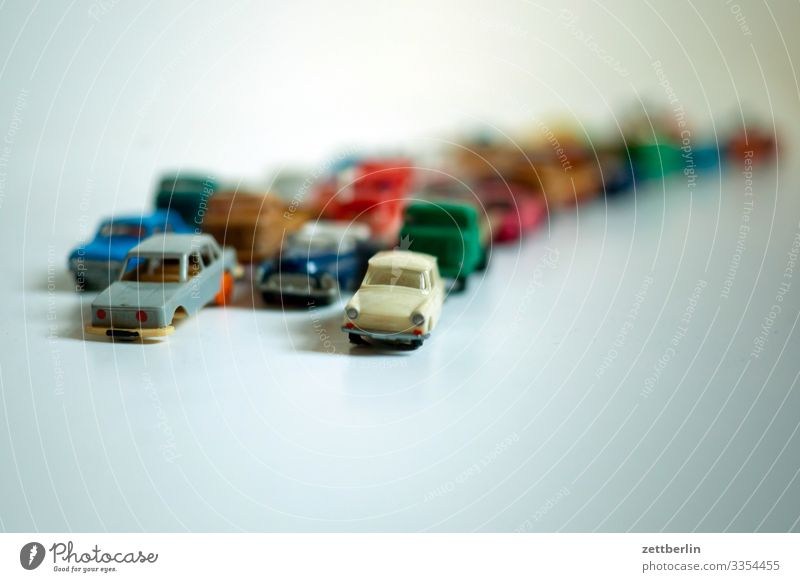 Traffic jam again Car Driving Motor vehicle mass Crowd of people Replication Row Toys Tracks Stand Street Road traffic Speed Transport Highway Curve Arch Many