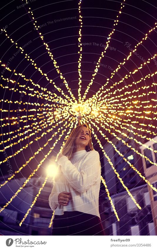 Young woman enjoying the Christmas decoration in Vigo, Galicia, Spain vigo galicia christmas lighting lights bokeh young exterior scene outside seasonal blue