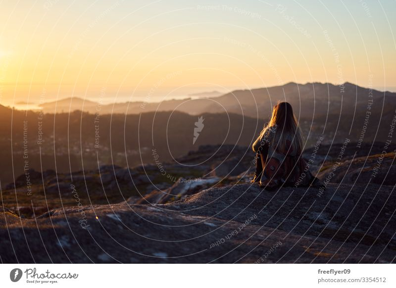 Young woman contemplating the sunset from Mount Galiñeiro in Vigo, Galicia, Spain alps idyllic nature feet mountains morning romantic meadow serene calm